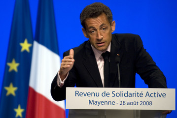 France's President Nicolas Sarkozy delivers a speech in Change, western France