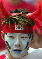 A SUPPORTER FOR SOUTH KOREA WEARS DEVIL HORNS IN TAEGUGU.