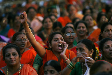 A woman shouts political slogans during a joint election rally of India's main opposition Bharatiya Janata Party  and Hindu hardline party Shiv Sena in Mumbai