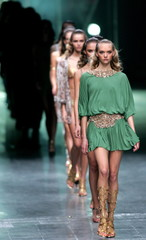 Models present creations by English designer Alexander McQueen during the presentation of his Spring..