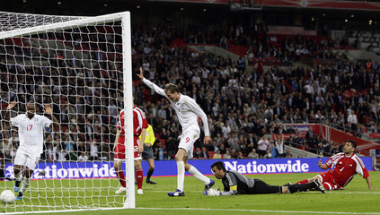 England's Crouch scores past Andorra's Alvarez during their World Cup 2010 qualifying soccer match in London