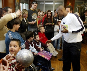 FC Barcelona's soccer player Samuel Eto'o gives presents during a charity visit to the 'Sant Joan de ...