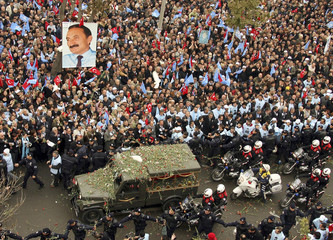 Turkish riot policemen control the crowd as former prime minister Bulent Ecevit's coffin arrives in a military hearse in front of his party headquarters in Ankara