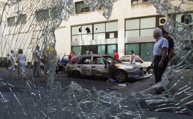 RESIDENTS VIEW A BURNT OUT CAR IN GENOA FOLLOWING RIOTING DURING THE G8SUMMIT.