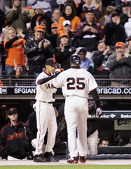 Giants Bonds gets high five from son after being lifted for pinch runner during baseball game against Diamondbacks in San Francisco