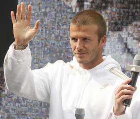 U.S. soccer club Los Angeles Galaxy midfielder David Beckham of Britain wavess to his South Korean fans during a promotional event in Seoul