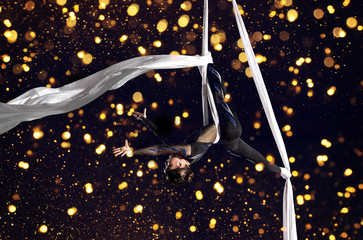 Young woman circus air gymnast