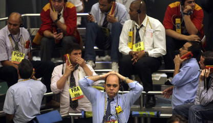 Traders work on the main floor of the BM&F Bovespa stock exchange market in Sao Paulo