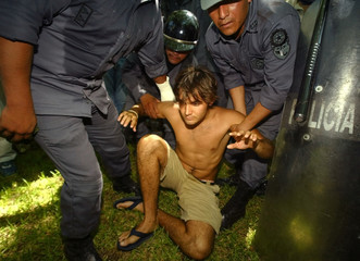 POLICE DETAIN SON OF WEALTHY BUSINESSMAN DURING ANTI WTO CLASHES.