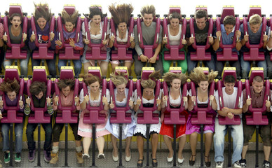 People enjoy a ride in a roller coaster at the traditional Bavarian beer festival Oktoberfest in Munich