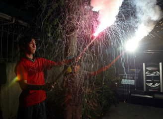 FILIPINO CHILDREN LIGHT FIREWORKS TO WELCOME NEW YEAR IN MANILAH.