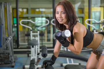 Asian beautiful woman muscular fit woman exercising building muscles