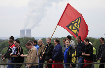 Members of Germany's metal workers union 'IG Metall' march during a demonstration in Schweinfurt