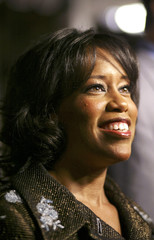 """Cast member Regina King smiles as she arrives for the premiere of """"Miss Congeniality 2 - Armed and Fabulous""""."""
