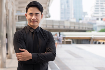 confident, happy, successful asian businessman arm crossing