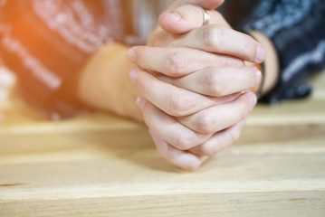 closeup of man hand praying in soft tone