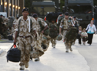 Soldiers of 33 Armoured Engineer Squadron return to Swinton Barracks at Parham Down near Tidworth in south west England