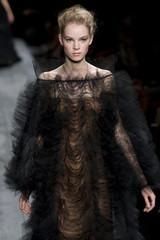 A model presents a creation for Italian fashion house Valentino as part of their Haute Couture Autumn-Winter 2009-2010 fashion show in Paris