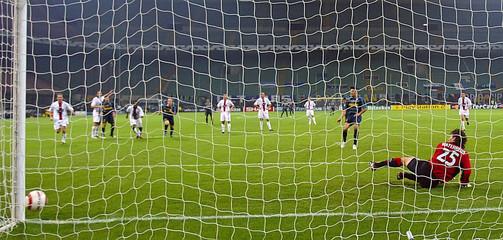Inter Milan's Cruz misses penalty as Rangers' goalkeeper Waterreus dives wrong way during Champions League match in Milan
