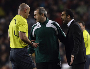Barcelona's coach Guardiola argues with referee  Webb after being expelled during his Champions League quarter-final, first-leg soccer match against Bayern Munich
