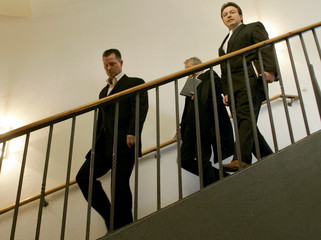 Former German athletics coach Springstein and his lawyers leave trial at district court in Magdeburg