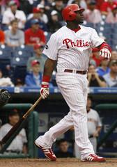 Phillies Howard watches his three run home run against the Giants in Philadelphia