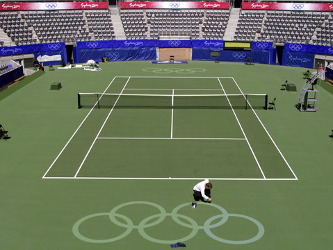 A WORKER PAINTS THE OLYMPIC LOGO ON CENTER COURT.