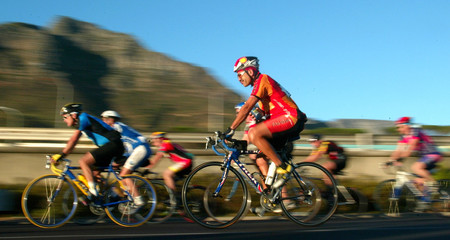 DAWN RISES ON CYCLISTS TAKING PART IN CAPE TOWNS ARGUS CYCLE TOUR.