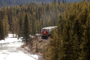 A CP Rail train rolls across the prairies into the rocky mountains of near Canmore.