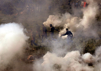 ISRAELIS DISPERSE PALESTINIAN DEMONSTRATORS WITH TEAR GAS.