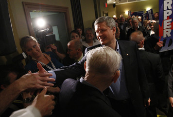 Conservative leader and Canada's PM Harper shakes hands with supporters during a campaign rally in Courtenay