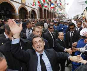 France's President Sarkozy and Algeria's President Bouteflika walk in the old city of Constantine