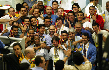 A TRADER TAKES A PICTURE AT FUTURE AND COMMODITIES MARKET IN SAO PAULO.