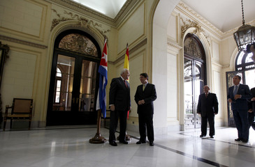 Cuba's Foreign Minister Bruno Rodriguez and his Spanish counterpart Miguel Angel Moratinos pose for pictures at the Cuban Foreign Office