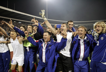 Serbia and Montenegros players celebrate their win over Bosnia after their World Cup 2006 qualifying soccer match in Belgrade
