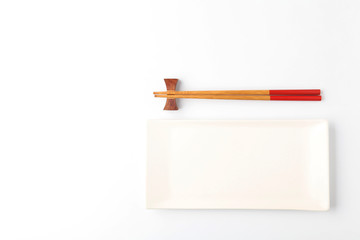 Empty plate and chopsticks on white Background