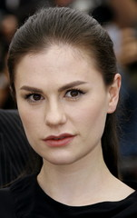 New Zealand actress Anna Paquin poses during a photocall for [U.S. director Brett Ratner]'s out of c..