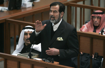 """Ousted Iraqi President Saddam discusses prosecution evidence during the """"Anfal"""" genocide trial in Baghdad"""