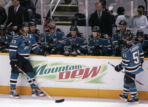 Sharks Thornton and Campbell wait at the bench as the NHL reviews Stars goal during th second period in Game 5 of their NHL Western Conference semi-finals