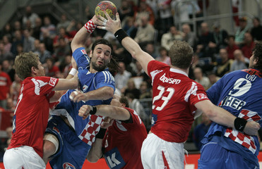 Croatia's Balic tries to score past Denmark's Boldsen during their Handball World Cup group M2 match in Mannheim