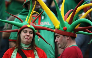 Fans wait for the start of the Group D World Cup 2006 soccer match between Portugal and Mexico in Gelsenkirchen
