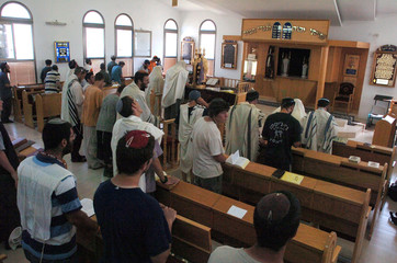 Israeli settlers pray in synagogue in the Jewish settlement of Morag.