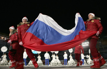 Russian athletes wave their national flag during opening ceremony of the Winter Olympic Games