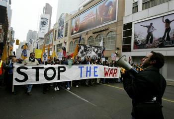 ANTI-WAR DEMONSTRATORS MARCH THROUGH THE STREETS OF TORONTO.