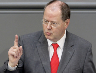 German Finance Minister Steinbrueck makes point during speech in Berlin