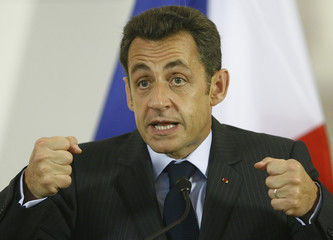 French President Nicolas Sarkozy addresses a news conference in Vienna