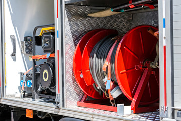 fire hoses and other fire fighting equipment on board a fire truck