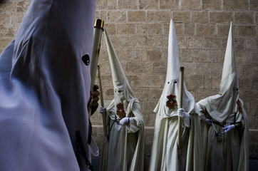 """Penitents take part in the procession of """"Santo Cristo de la Sang"""" brotherhood during Holy Week in Palma de Mallorca"""