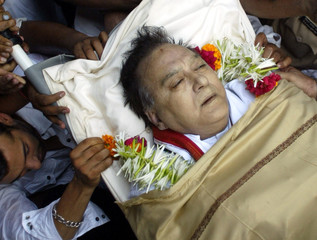 Relatives and Bollywood stars carry the body of former bollywood icon Sunil Dutt outside his ...