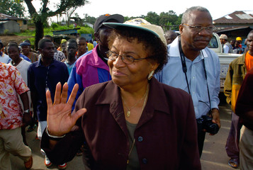 Liberias presidential candidate Ellen Johnson-Sirleaf waves to well-wisher after voting in Tubmanburg